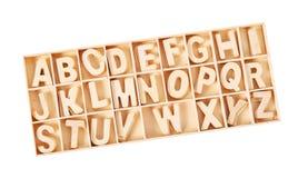 Alfabeto de madera de ABC de las letras para el niño en caja Foto de archivo