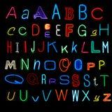 Alfabeto de neón Foto de archivo libre de regalías
