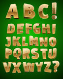Alfabeto de oro del vector Foto de archivo