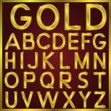 Alfabeto de oro del vector Imagen de archivo libre de regalías