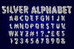 Alfabeto de prata em um fundo escuro Imagens de Stock Royalty Free