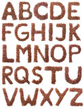 Alfabeto del café de Brown aislado en blanco Imagen de archivo libre de regalías