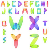 Alfabeto del caramelo del arco iris con los jems multicolores Fotografía de archivo libre de regalías