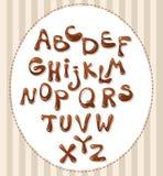 Alfabeto del cioccolato isolato su fondo bianco Fotografia Stock
