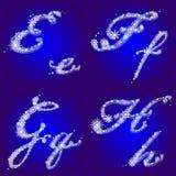 Alfabeto del invierno con las letras E, F, G, H de los copos de nieve Fotografía de archivo