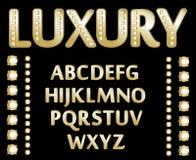 Alfabeto del oro Imagen de archivo libre de regalías