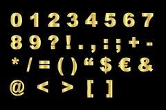 Alfabeto del oro - números y símbolos Imagen de archivo libre de regalías