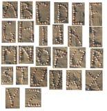 Alfabeto delle coperture Immagini Stock