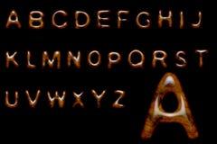 Alfabeto di legno lucido Fotografia Stock