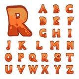 Alfabeto di pietra rosso del gioco Immagini Stock
