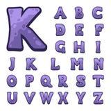 Alfabeto di pietra viola del gioco Fotografia Stock