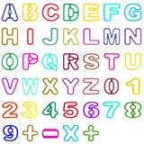 Alfabeto di plastica e numero vuoti della raccolta isolati su bianco Fotografia Stock