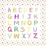 Alfabeto disegnato a mano colorato sul fondo del pois Fotografia Stock