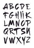Alfabeto disegnato a mano nel retro stile ABC per la vostra progettazione Lettere dell'alfabeto scritto con una spazzola Fotografia Stock