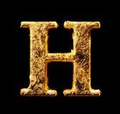 Alfabeto e números na folha de ouro Imagem de Stock Royalty Free
