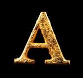 Alfabeto e números na folha de ouro Fotos de Stock Royalty Free