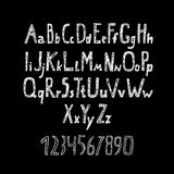 Alfabeto e numeri disegnati gesso Fotografia Stock