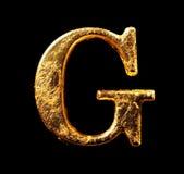 Alfabeto e numeri in foglia di oro Immagini Stock