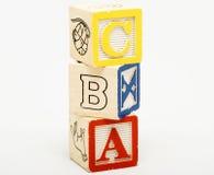 Alfabeto empilado que aprende los cubos Fotografía de archivo libre de regalías