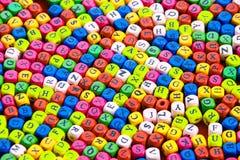 alfabeto en el cupe de madera en concepto del color imágenes de archivo libres de regalías