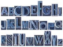 Alfabeto en tipo mezclado del metal de la prensa de copiar Fotografía de archivo