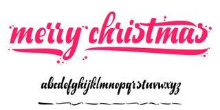 Alfabeto - Feliz Navidad, insignia de Navidad con las letras manuscritas Imagen de archivo libre de regalías