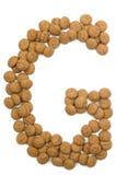 Alfabeto G de la tuerca del jengibre Imagenes de archivo