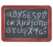 Alfabeto griego en la pizarra Fotos de archivo