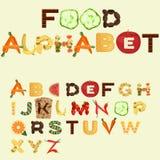 Alfabeto hecho de diversa comida, diseño plano Fotografía de archivo