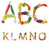 Alfabeto hecho de frutas y verdura Imagen de archivo libre de regalías