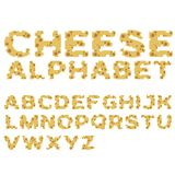 Alfabeto hecho del queso en diseño plano Imágenes de archivo libres de regalías