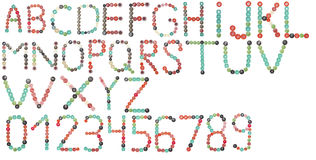 Alfabeto inglês e números completos de botões das cores Fotos de Stock Royalty Free