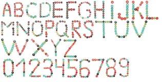 Alfabeto inglese e numeri completi dei bottoni di colori Fotografie Stock Libere da Diritti