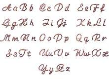 Alfabeto inglese fatto dei chicchi di caffè Fotografie Stock Libere da Diritti