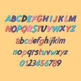 Alfabeto latino coloreado Fuente del ` s de los niños en estilo lindo de la historieta Letras mayúsculas y mayúsculas y números Fotos de archivo libres de regalías