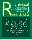 Alfabeto latino del carbone sulla lavagna Fotografia Stock