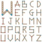 Alfabeto latino fatto del meccano di legno Fotografie Stock