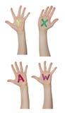 Alfabeto (letras) pintado nas mãos das crianças Aumentam acima as mãos fotografia de stock royalty free