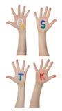 Alfabeto (letras) pintado nas mãos das crianças Aumentam acima as mãos foto de stock royalty free