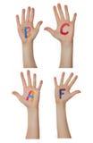 Alfabeto (letras) pintado nas mãos das crianças Aumentam acima as mãos fotografia de stock