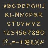 Alfabeto manuscrito del oro Imagen de archivo libre de regalías
