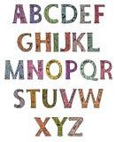 Alfabeto Mayúsculas adornadas con los estampados de flores coloreados ilustración del vector