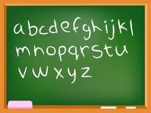 Alfabeto minúsculo de la pizarra Imagenes de archivo