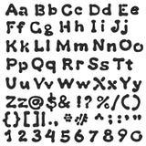 Alfabeto negro de la mancha blanca /negra manuscrito Imagenes de archivo
