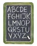 Alfabeto no giz no quadro-negro Fotos de Stock