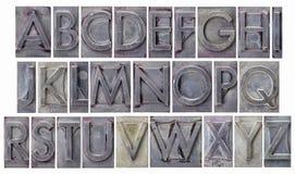 Alfabeto no tipo do metal do grunge Imagens de Stock Royalty Free