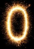 Alfabeto O da luz do fogo de artifício do chuveirinho e número zero isolado no preto Fotografia de Stock