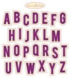 Alfabeto púrpura y amarillo de la puntada Foto de archivo libre de regalías
