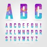 Alfabeto polivinílico bajo en concepto del polígono Fotos de archivo