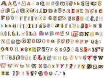 Alfabeto rasgado del periódico Fotografía de archivo
